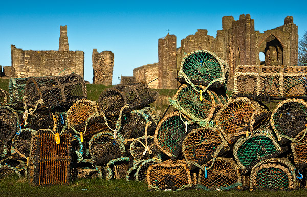 Lindisfarne Abbey with crab pots. Fine Art Landscape Photography by Gary Waidson